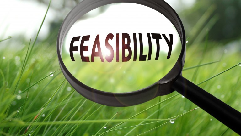 Words in magnifying glass spelling 'feasibility'